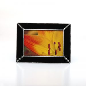 Black frame with yellow and orange lily