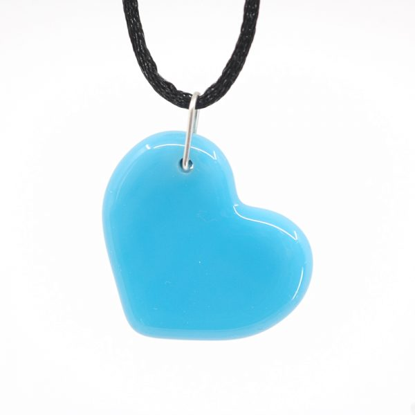 Baby blue heart hanging at an angle
