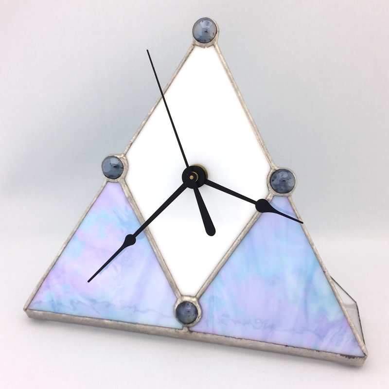 Triangular Clock with white diamond face and two blue triangles at base