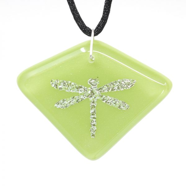 Silver dragonfly on light green pendant