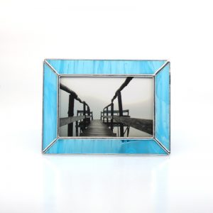 Light blue frame showing picture of a wooden pier