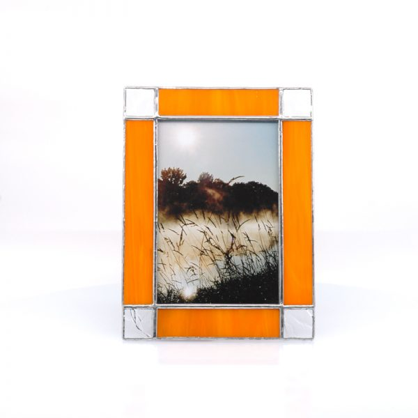 Orange frame with clear corners with picture of mist on river