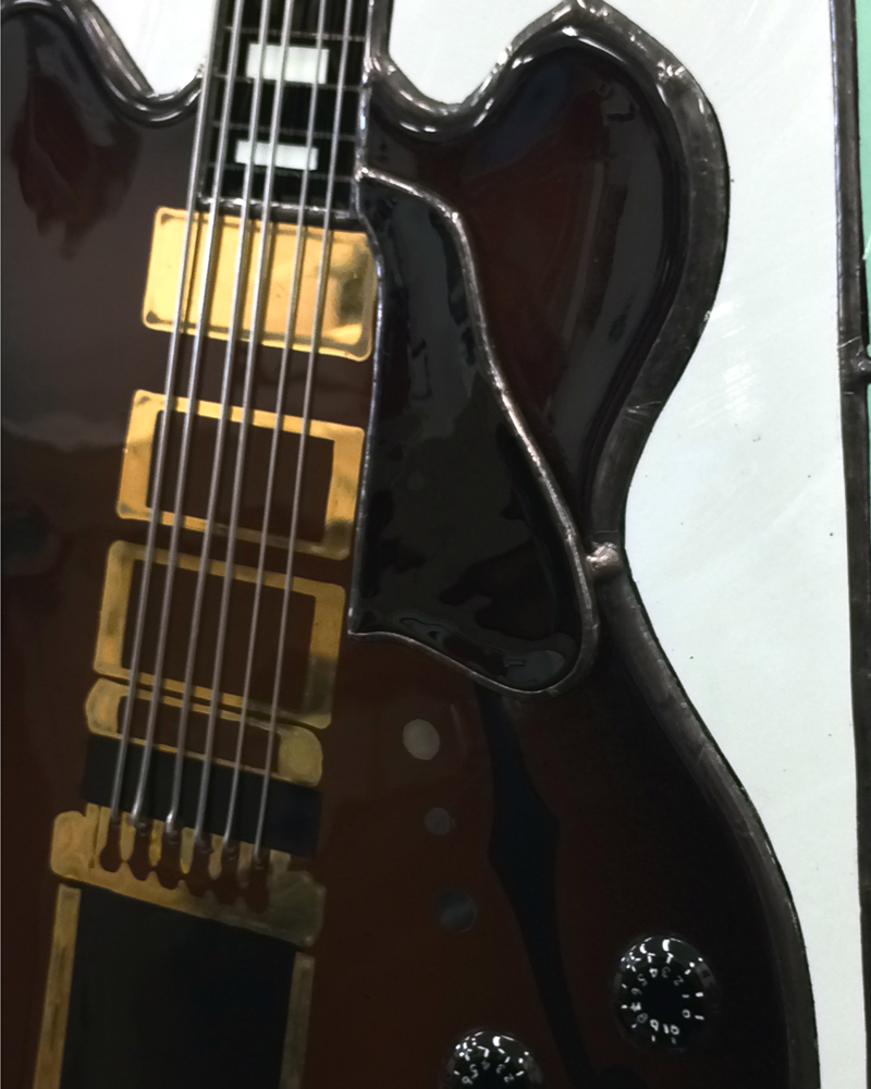 Closeup of stained glass guitar