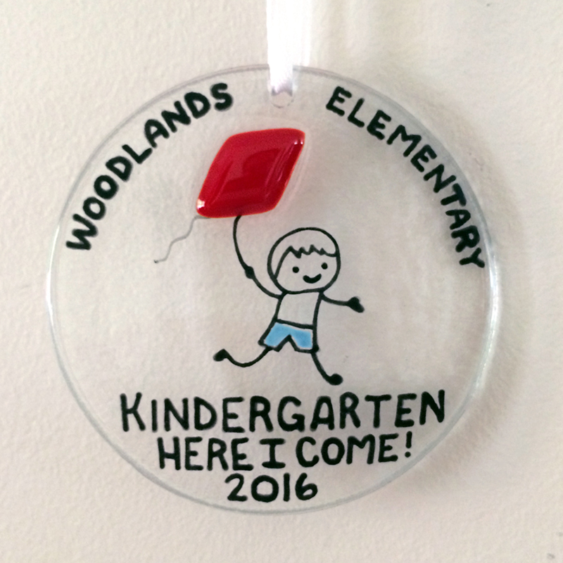 Kindergarten Medallion with child flying red kite