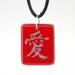 Chinese character for Love in silver on red pendant