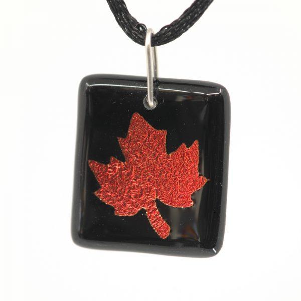 Red maple leaf on black pendant