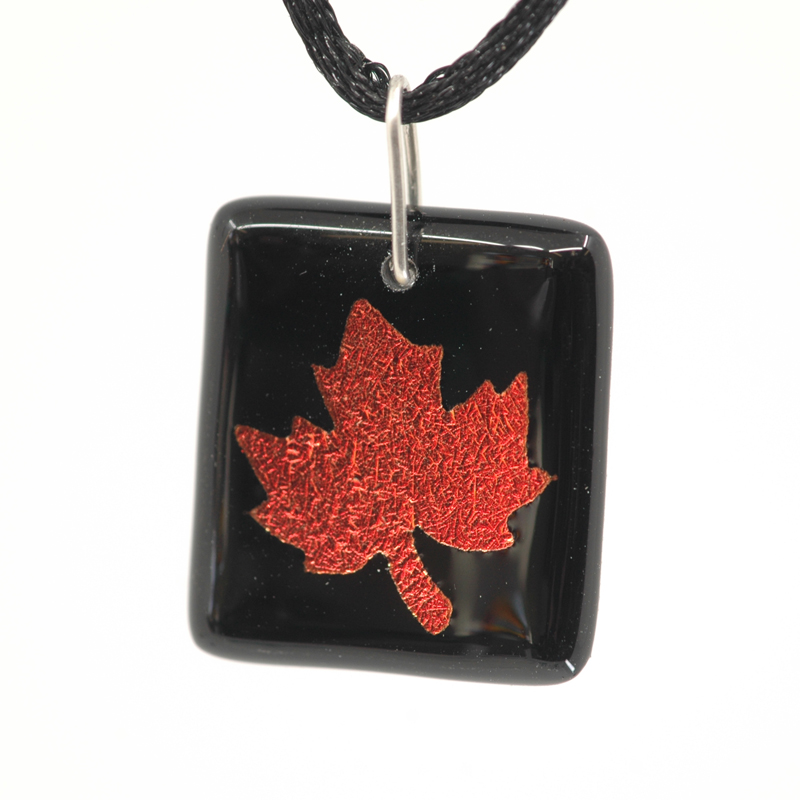 Red maple leaf on black pendant