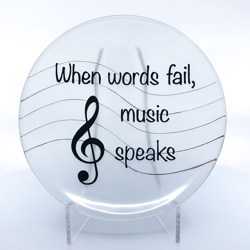 Clear bowl with quote When Words Fail, Music Speaks, with a treble clef
