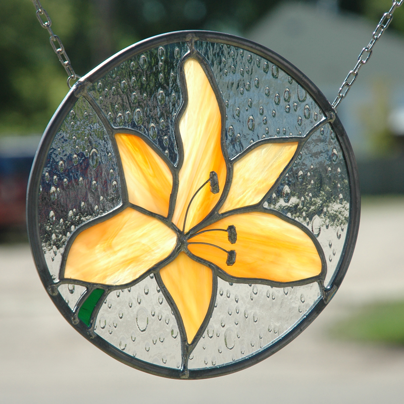 Round stained glass of orange lily