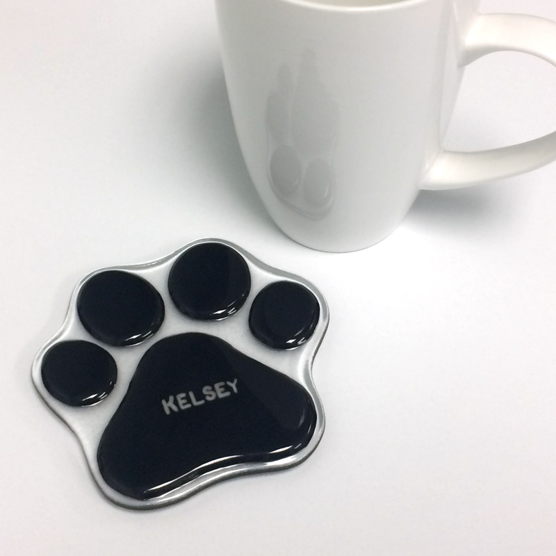 Dog paw print with custom name written in silver
