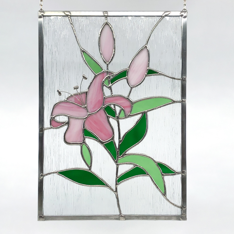Stained glass of pink lilies