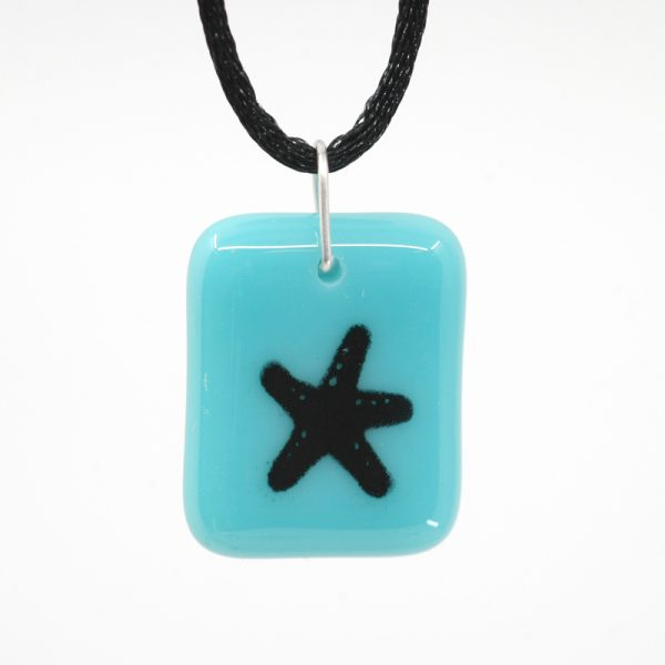 Black starfish painted on a blue pendant
