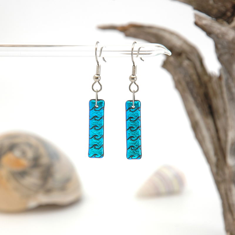 Bright sparkly aqua blue glass earrings with black waves with seashells and driftwood