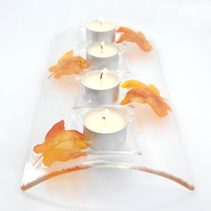 Clear Candle bridge with leaves holding four tealights