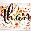 Close upHandpainted Thankful on Clear glass with red and orange speckles