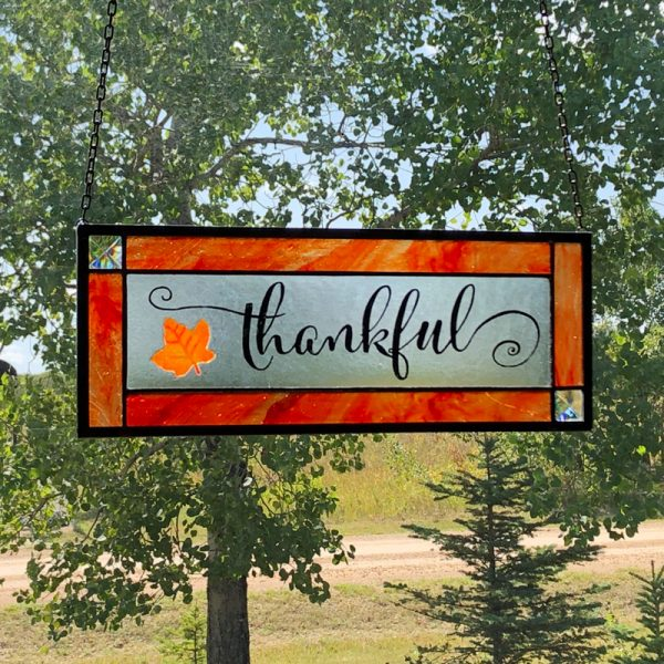 Stained Glass with Thankful painted in centre