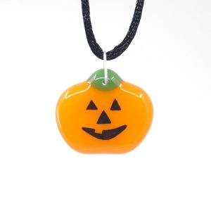 Fused glass pumpkin with Jack-o-lantern face hand painted