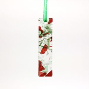 Red and green ornament with confetti on clear glass