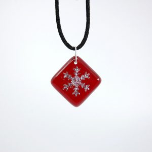 Snowflake on red fused glass