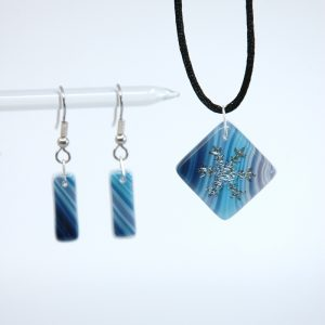 Snowflake pendant and earrings on swirled purple and blue fused glass