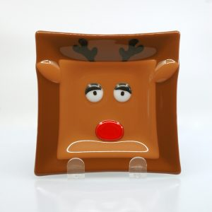 Tired reindeer fused glass plate