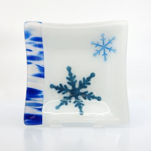 Snowflake fused glass plate with blue stripes on side