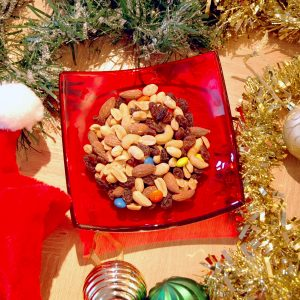 Holly Berry Red Fused Glass Bowl with mixed nuts