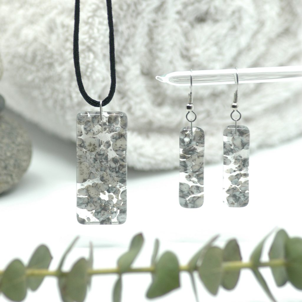 Fused Glass River Rock Pillar Jewelry Set with river rocks, spa towel, and branch