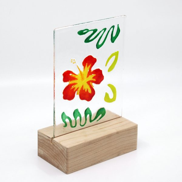 Red Hibiscus flower with jungle green leaves on clear fused glass