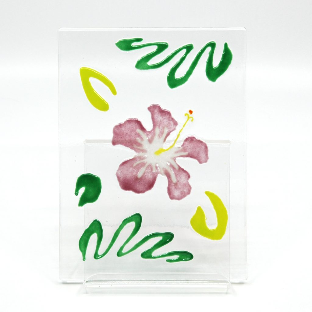 Pink Hibiscus flower with jungle green leaves on clear fused glass