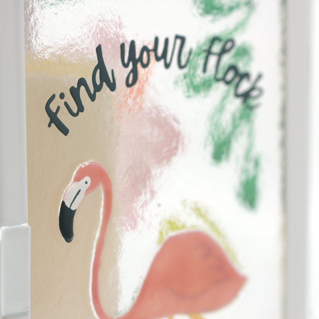 Close up of Fused Glass Flamingo Lantern Find Your Flock