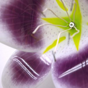 Close up of White and Purple Fused Glass Patricia's Pride Lily