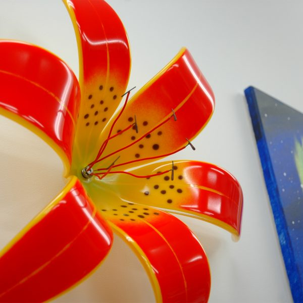 Close up of Orange and Yellow Fused Glass Western Red Lily wall mounted